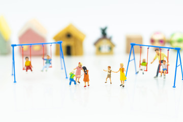 Miniature people : children playing together. Image use for happy family day concept.