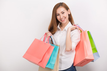 Very happy beautiful young woman in casual clothing with shopping bags