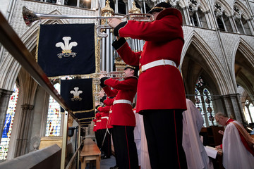 Trumpeters play a fanfare as the Prince of Wales, Great Master of the Honourable Order of the Bath, attends the Service of Installation of Knights Grand Cross of the Order at Westminster Abbey in central London