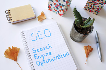 SEO Search Engine Optimization written in notebook on white table