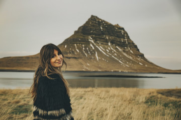 Young caucasian woman turning back in Kirkjufell Mountain