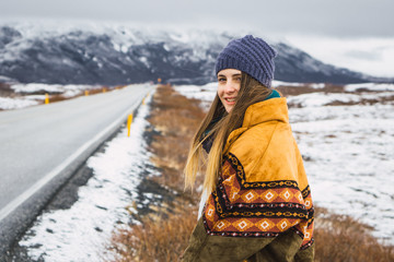 Beautiful woman in outwear in cold nature