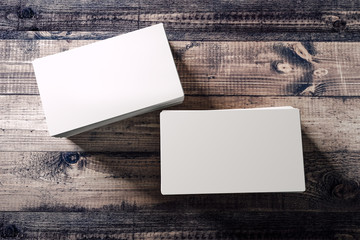 3d blank white business cards on wooden background