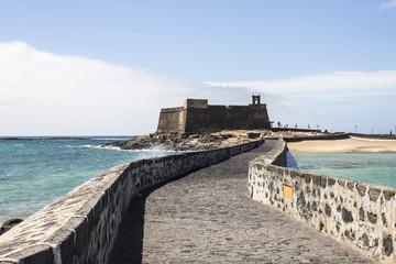 Spanish fortressof Lanzarote at rough sea