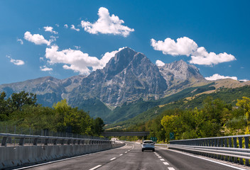 An highway in Italy; the mountain Gran Sasso in background