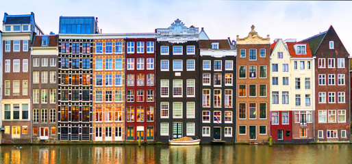 Spoed Fotobehang Amsterdam Amsterdam, The Netherlands, May 4th 2017: Row of authentic canal houses on the Rokin in Amsterdam