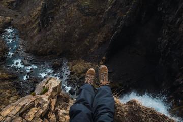 Crop legs of man on mountains
