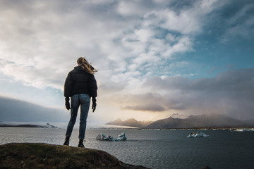 Tourist standing on cold seascape