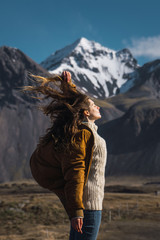 Woman with flaying hair in mountains