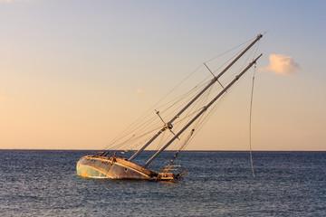 Acrylic Prints Shipwreck Shipwrech. sinking yacht and sunset colors