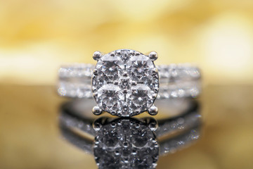 Luxury gold Jewelry diamond rings with reflection on black background