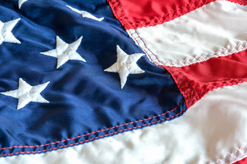 close up of American flag with embroidered stars