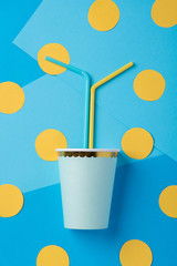 Straws for a party in paper cup on a bright background