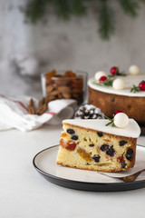 Traditional Christmas Fruit Cake pudding with marzipan and rosemary decor on plate. Copy space. Christmas concept.