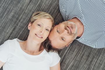 loving couple lying on the sofa