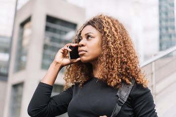 Attractive African woman taking a mobile call