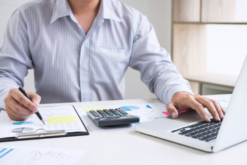 Business accountant or banker, businessman calculate and analysis with stock financial indices and financial costs wisely and carefully, investment and saving concept