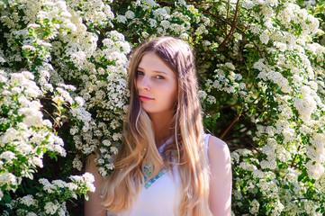 Beautiful young Ukrainian woman in white flowers