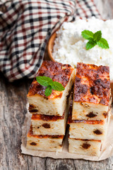 Homemade  cottage cheese casserole slices on wooden table