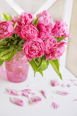 A beautiful bouquet of pink peonies. Bright, gentle interior.