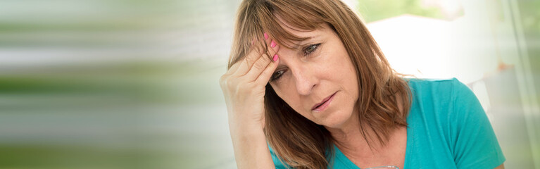 Mature woman having a headache