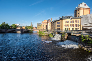 Motala river and the industrial landscape of Norrkoping. Norrkoping is a historic industrial town in Sweden.