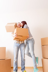 Image of couple in love among cardboard boxes