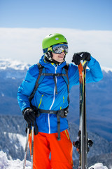 Photo of sporty man with skis
