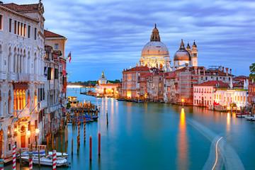Grand canal and The Basilica of St Mary of Health or Basilica di Santa Maria della Salute at night in Venice, Italy