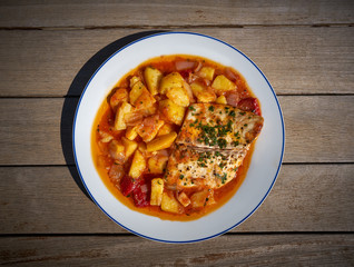 Seabass fish recipe oven with tomatoes and potato