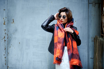 fashion model in fashion glasses and black leather jacket outdoor