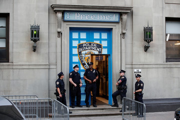 Police officers stand in front of the 1st Precinct in Manhattan as film producer Harvey Weinstein is expected to arrive, in New York