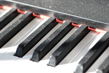 Dusty piano keys. Reluctant musician concept image showing a lack of music practice.