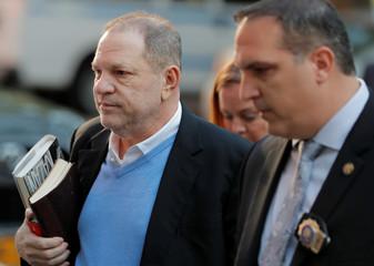 Film producer Harvey Weinstein arrives at the 1st Precinct in Manhattan in New York