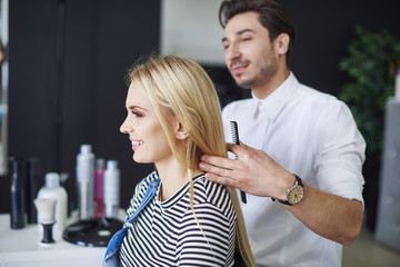 Smiling woman at the hairdresser