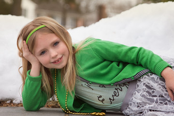 adorable school age girl dressed in lucky green for saint patrick's day holiday