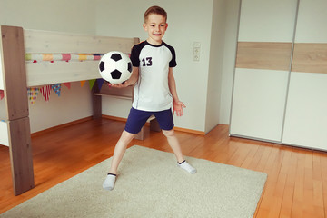 A cute boy with ball looks forward to world cup