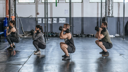 Sportspeople Doing Squats at Gym