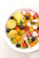 vegetable salad with potato,radish and tomato