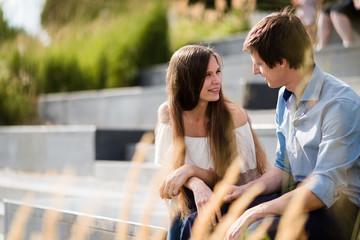 Teenage couple sitting on an elevated platform