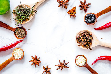Cooking with spices, vanilla, cinnamon on kitchen table backgrou