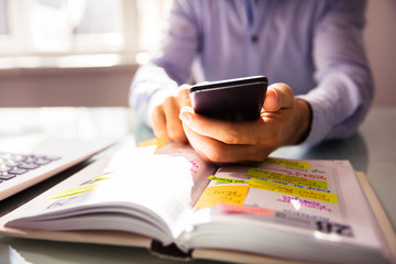 Fototapete - Businessperson Using Mobile Phone