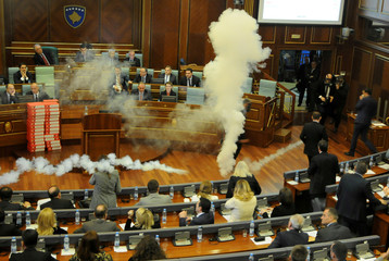 Kosovo opposition politicians release tear gas in parliament to obstruct a session in Pristina