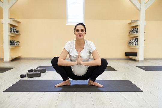 Pregnant Women Doing Yoga