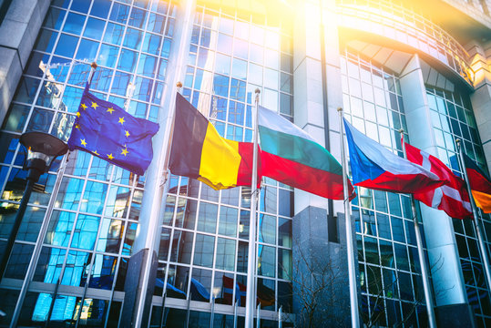 Waving flags in front of European Parliament building, Brussels