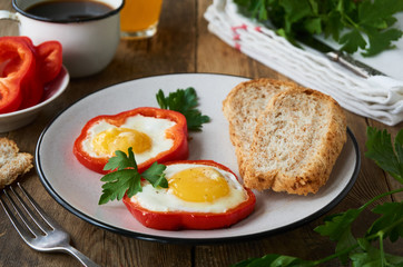 Fried eggs in pepper on a plate