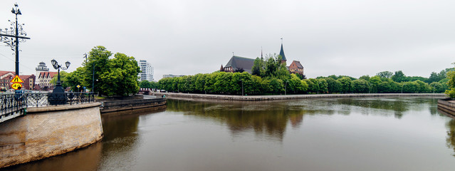 Kaliningrad city with Kant`s island and cathedral on a background and river on a foreground
