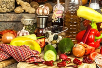 Preparation of vegetable salad in the kitchen. Fresh vegetables on a kitchen board. Healthy diet food.