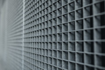 Metal lattice with small cells grid stock background with shallow dof and selective focus