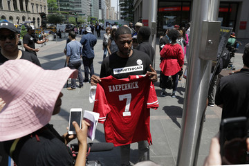 New York City Council member Jumaane D. Williams joins protesters rallying outside the NFL headquarters against the league's new national anthem policy, in New York